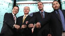 2011 Hall of Fame inductees Doug Gilmour, Mark Howe, Joe Nieuwendyk and Ed Belfour show off their Hall of Fame rings during a photo opportunity at the Hockey Hall of Fame on Monday. (Bruce Bennett/2011 Getty Images)