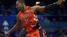Toronto Raptors guard Terrence Ross (31) celebrates with a teammate during a timeout after scoring a three-pointer in the second half of an NBA basketball game against the Orlando Magic in Orlando, Fla., Saturday, Dec. 29, 2012. The Raptors won 123-88. (Phelan M. Ebenhack/AP)