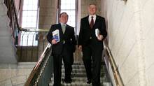 Prime Minister Stephen Harper (R) and Finance Minister Jim Flaherty (L) walk to the House of Commons to deliver the budget on Parliament Hill in Ottawa. (Dave Chan for The Globe and Mail/Dave Chan for The Globe and Mail)