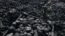 Coal is loaded onto a cart at a coal mine. (Reuters)
