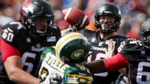 Stampeders QB Bo Levi Mitchell readies to throw the ball on Monday. The Calgary offence rolled to 28 points, but it was the D that led the way, holding Edmonton without an offensive touchdown. (Jeff McIntosh/THE CANADIAN PRESS)