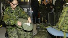 Lieutenant Alayna Kang of the Disaster Assistance Response Team (DART) prepares for deployment to the Philippines at Canadian Forces Base Trenton on November 11, 2013. (Corporal Darcy Lefebvre)