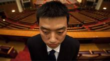 A security guard stands on duty after the opening session of the Chinese People's Political Consultative Conference in Beijing's Great Hall of the People, China, Thursday, March 3, 2011. (Ng Han Guan/AP/Ng Han Guan/AP)