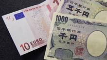 A 10 euro note (L) is spread out next to Japanese yen notes at a Bureau de Change in Brussels. (FRANCOIS LENOIR/FRANCOIS LENOIR/REUTERS)