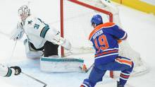 Edmonton Oilers left winger Patrick Maroon attempts to shoot the puck against San Jose Sharks goalie during the first period at Rogers Place, March 30, 2017/ (Walter Tychnowicz/USA Today Sports)
