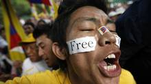 A Tibetan exile shouts slogans during a protest to mark the 52nd anniversary of the Tibetan uprising against China, in New Delhi March 10, 2011. (ADNAN ABIDI/Adnan Abidi/Reuters)