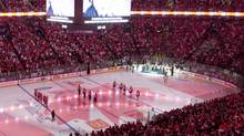 In this file photo Players from the Montreal Canadiens and the Philadelphia Flyers stand for the Canadian national anthem at the Bell Centre in Montreal, Thursday, May 20, 2010, prior to game 3 of their NHL hockey Eastern Conference final series. In the latest developments at the NHL meetings in Florida, several general managers are suggesting the league to the type of hybrid icing now used in the NCAA and USHL. THE CANADIAN PRESS/Graham Hughes (Graham Hughes)