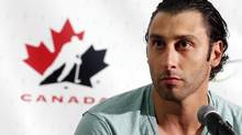 Roberto Luongo, of Montreal, Que., speaks to reporters at the Canadian national men's team orientation camp in Calgary, Alta., on Sunday, Aug. 25, 2013. (Jeff McIntosh/THE CANADIAN PRESS)