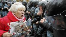 A supporter of Ukrainian former prime minister Yulia Tymoshenko shouts at riot police during a rally near the Pecherskiy district court in Kiev Oct. 11, 2011. (Alexandr Kosarev /Reuters)