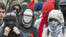 Masked protesters take part in an anti-capitalist demonstration in Montreal, Tuesday, May 1, 2012. Conservative MPs have agreed to impose a maximum 10-year prison term on protesters who wear masks during a riot. (Graham Hughes/THE CANADIAN PRESS)