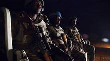 UNAMID peacekeepers from Ethiopia prepare to go on a night patrol on a pick-up vehicle, in Gereida (South Darfur), July 25, 2012. (Albert Gonzalez/REUTERS)
