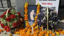 Flowers near the picture of Late Dana Sangma. Amity University students protested against the school's administration for their alleged role in her suicide on May 1, 2012 in Gurgaon, India. (Hindustan Times/Newscom)