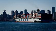 The container ship Cosco Yokohama is guided into port in Vancouver. (DARRYL DYCK FOR THE GLOBE AND MAIL)