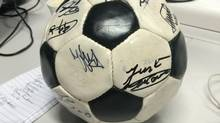 This official World Cup ball bears the autographs of some of the greatest players in soccer history. For some reason, its owner has opted to cart it along at this tournament, where it may become a target for thieves. (Cathal Kelly/The Globe and Mail)