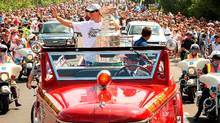 Pittsburgh Penguins captain Sidney Crosby waves to thousands of fans from the top of a vintage fire engine as he parades the Stanley Cup through his community of Cole Harbour , Nova Scotia. (PAUL DARROW/PAUL DARROW/REUTERS)