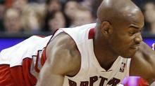 Raptors Jarrett Jack battles for the ball against the Chicago Bulls during the second half of their NBA preseason basketball game in Toronto, October 20, 2010. REUTERS/Mark Blinch (MARK BLINCH)