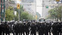 Riot police occupy the intersection of Spadina and Queen streets in Toronto on June 27, 2010, during protests against the G20 summit. (IAN WILLMS FOR THE GLOBE AND MAIL)