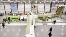 Bombardier Aerospace employees assemble a Q400 airliner (Darren Calabrese/THE CANADIAN PRESS)
