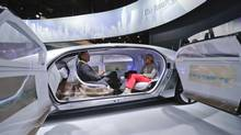 Attendees sit in the self-driving Mercedes-Benz F 015 concept car at the Mercedes-Benz booth at the International CES Jan. 6, 2015, in Las Vegas. (Jae C. Hong/AP)