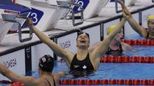 Canada's Valerie Grand-Maison celebrates after winning the gold medal by setting a new world record in the women's 200m independent medley SM13 final at the 2012 Paralympics, Friday, Sept. 7, 2012. (Lefteris Pitarakis/AP)