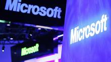 Microsoft logos hang over their booth on the opening day of the International Consumer Electronics Show (CES) in Las Vegas in this file photo taken January 10, 2012. (RICK WILKING/REUTERS)