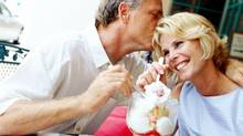 portrait of a mature couple sharing a sundae and kissing at a caf+?? (Stockbyte/(c) Stockbyte)