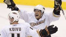 Anaheim Ducks sniper Teemu Selanne, right, celebrates his game-winning overtime goal with teammate Saku Koivu, left, against the Vancouver Canucks during preseason NHL action at GM Place in Vancouver, Thursday, Sept. 24, 2009. The Ducks won the game 3-2. (Jonathan Hayward)