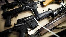 Various assault rifles seized by the Combined Forces Special Enforcement Unit of British Columbia are displayed during a press conference in Delta, B.C., on Oct. 25, 2012. (Rafal Gerszak for The Globe and Mail)