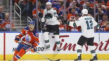 San Jose Sharks' Melker Karlsson and Patrick Marleau celebrate a goal as Oilers' Darnell Nurse skates past during overtime NHL playoff action in Edmonton, Alta., on Wednesday, April 12, 2017. (JASON FRANSON/THE CANADIAN PRESS)