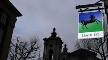 A Lloyds bank sign hangs outside a branch in London February 24, 2012. (STEFAN WERMUTH/REUTERS)