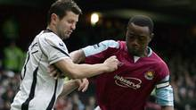 West Ham United's Nigel Reo-Coker, right, tussles with Fulham's Canadian Tomasz Radzinski, of Toronto,  for the ball during their English Premiership League soccer match at Upton Park, London, Saturday, Jan. 13, 2007. (Associated Press)