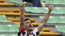 Udinese striker Antonio Di Natale celebrates after scoring during the Serie A soccer match between Udinese and Genoa, at the Friuli Stadium in Udine, Italy, Sunday. (Paolo Giovannini)