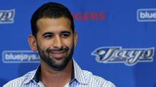 Toronto Blue Jays player Jose Bautista smiles during a news conference to announce a five-year contract with the team at their MLB American League spring training facility in Dunedin, Florida, February 17, 2011. (MIKE CASSESE)