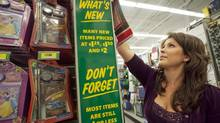 Dollarama employee restocks shelves at the store in Vaughan, Ont. (JENNIFER ROBERTS/Jennifer Roberts for the)
