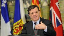 Federal Finance Minister Jim Flaherty answers questions at a news conference following a meeting with his provincial and territorial counterparts to discuss pensions, in Kananaskis, Alta. (Todd Korol/Reuters)