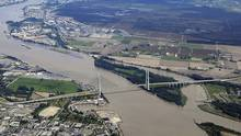 A bridge, seen in the conceptual rendering above, has been proposed to replace the George Massey Tunnel, which connects Richmond and Delta.