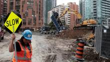 An excavator digs at a condominium construction site on what used to be a neighborhood of single family homes in Toronto. (Chris Helgren/Reuters)