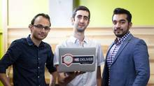 Toronto-based JoeyCo Inc. sends its freelance couriers around the city picking up and dropping off items. From left are three of its co-founders, President Abir Rais, chief technology officer Samer Ziade and CEO Inaam Shah of JoeyCo are photographed at the company's offices in Toronto (Kevin Van Paassen for The Globe and Mail)