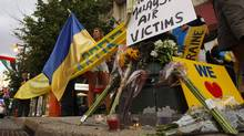 Ukrainians in Philadelphia gather Friday, July 18, 2014, on The Parkway for a vigil following the crash of Malaysia Airlines Flight MH17 in Ukraine. They will mourn the dead and to demand accountability from those responsible. (The Philadelphia Inquirer, Ron Cortes/AP)