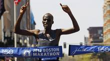 Wesley Korir of Kenya breaks the tape to win the men's division of the 116th Boston Marathon in Boston, Massachusetts April 16, 2012. (BRIAN SNYDER/BRIAN SNYDER/REUTERS)