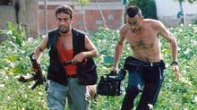 Cameraman Miguel Gil Moreno, right, follows a Kosovo Liberation Army (KLA) member in June 1998 in the province of Kosovo while covering the escalating conflict between ethnic Albanian fighters and Serb forces. It was Mr. Moreno's death in an ambush in Sierra Leone in 2000 that convinced Santiago Lyon to give up combat photography. (Santiago Lyon/AP)