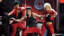 Justin Bieber performs at the 40th Anniversary American Music Awards on Sunday, Nov. 18, 2012, in Los Angeles. Bieber will perform at the Grey Cup halftime show Sunday. (AP - John Shearer/Invision/THE CANADIAN PRESS)