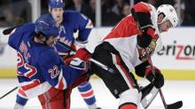 New York Rangers' Brian Boyle (22) and Ottawa Senators' Zenon Konopka (28) fight for control of the puck during the second period of Game 2 of a first-round NHL hockey playoff series Saturday, April 14, 2012, in New York. (Frank Franklin II/Associated Press)