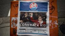 A copy of the free newspaper 24 Hrs Vancouver featuring a front-page B.C. Liberal Party advertisement with leader Christy Clark on May 1, 2013. (Darryl Dyck/The Canadian Press)