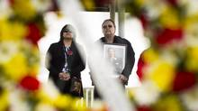 Lucy and Russell Campbell attend the National Day of Mourning ceremony in New Westminister, B.C., on April 29, 2014. Lucy's brother Carl Charlie died in the Lakeland Mills explosion in Prince George in 2012. (John Lehmann/The Globe and Mail)