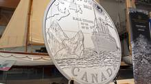 A Royal Canadian Mint commemorative silver coin, designed by artist Yves Berube to mark the 100th anniversary of the Titanic sinking, is unveiled in Halifax on Monday. (Andrew Vaughan/The Canadian Press/Andrew Vaughan/The Canadian Press)