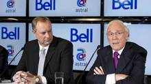 BCE president George Cope, left, and Astral Media CEO Ian Greenberg announced the takeover of Astral by Bell in March. (PAUL CHIASSON/THE CANADIAN PRESS)