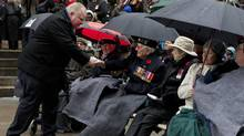 Toronto Mayor Rob Ford takes a moment to shake the hands of some veterans during Remembrance Day Ceremonies at Old City Hall Cenotaph in Toronto on November 11, 2013.