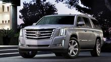 Push a button on this 2015 Cadillac Escalade and the tailgate raises and lowers automatically. (General Motors)