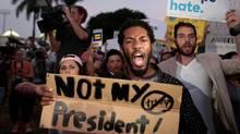 People protest against U.S. President-elect Donald Trump in Miami, Florida, U.S. November 11, 2016. (JAVIER GALEANO/REUTERS)